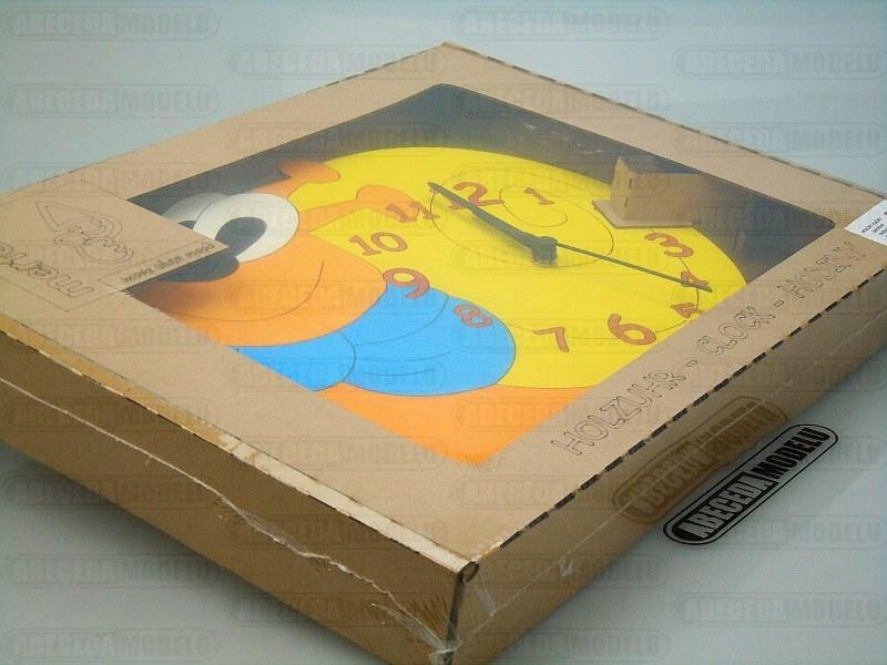 Dřevěné hodiny Šnek do dětského pokoje